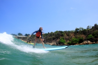 girl surfing first surf lesson puerto escondido