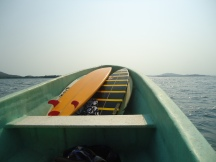 surf boards on the boat to hidden waves near puerto escondido