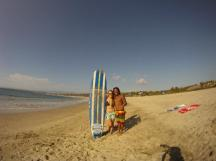 student and surf lesson instructor after the class