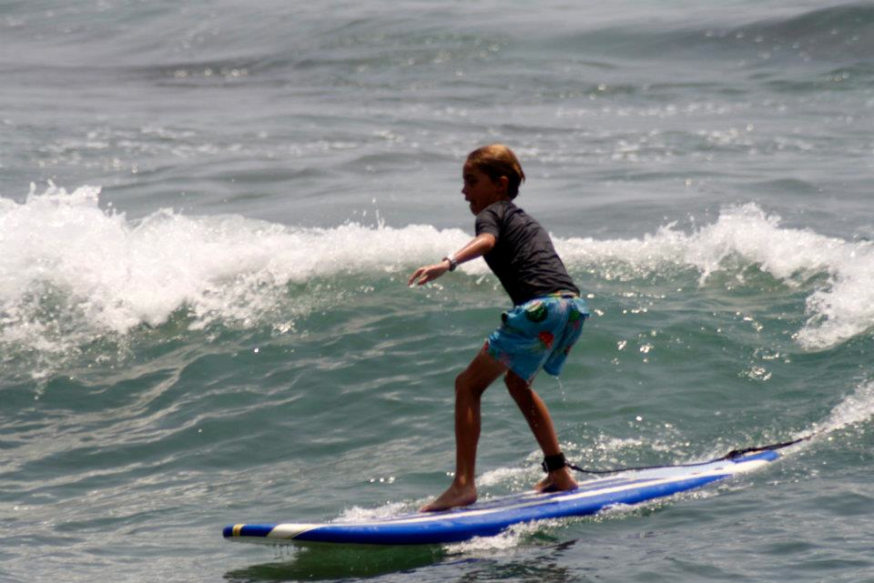 boy catching wave first surf lesson puerto escondido