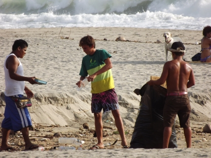 the kids cleaning the beach